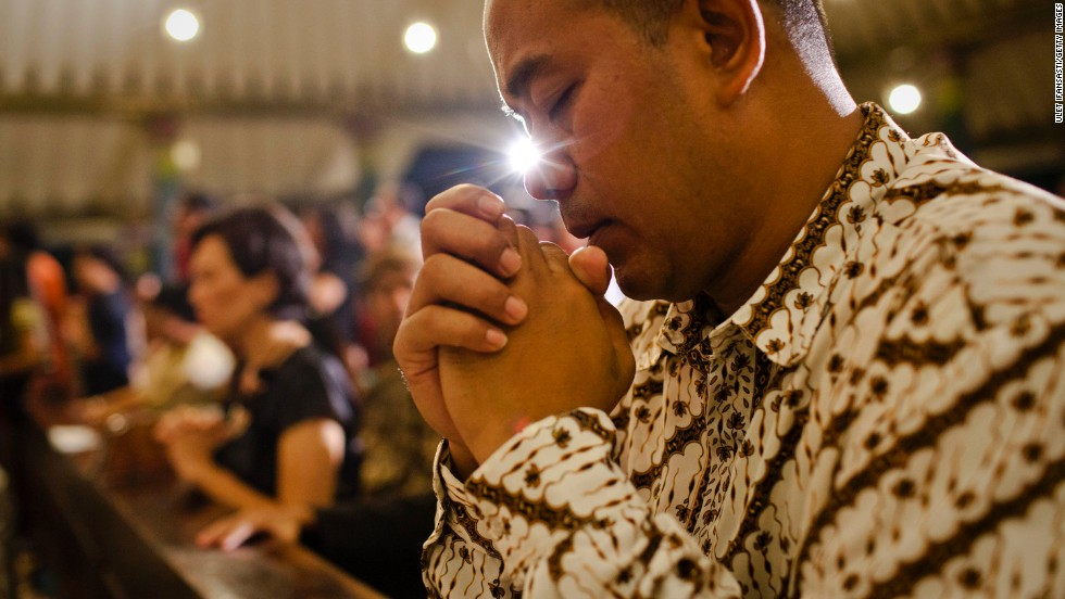 An Indonesian Javanese Christian prays during Christmas Eve Mass in Yogyakarta, Indonesia, on December 24.