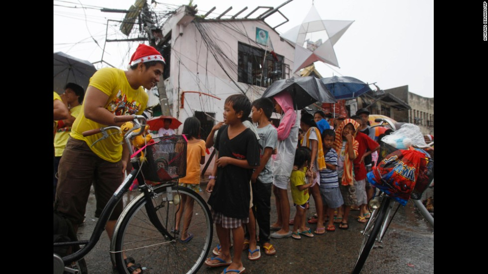 Children line up to receive Christmas gifts in Tacloban, Philippines, which was devastated by Typhoon Haiyan in November.