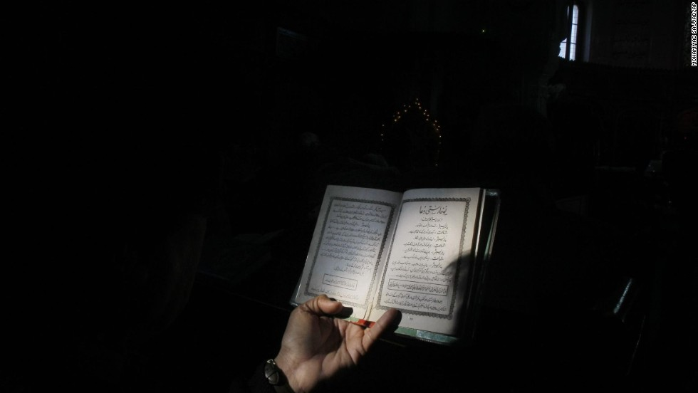 A Christian worshipper reads the Bible during Mass in Peshawar, Pakistan.