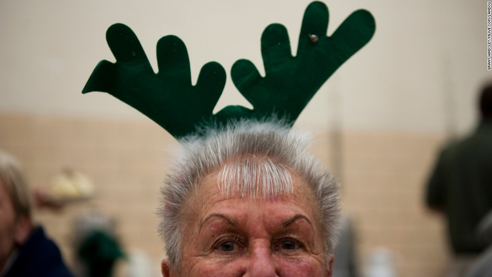 Jeanne Kubish poses for a portrait at Christmas dinner at Queen Miraculous Medal School in Jackson, Michigan.
