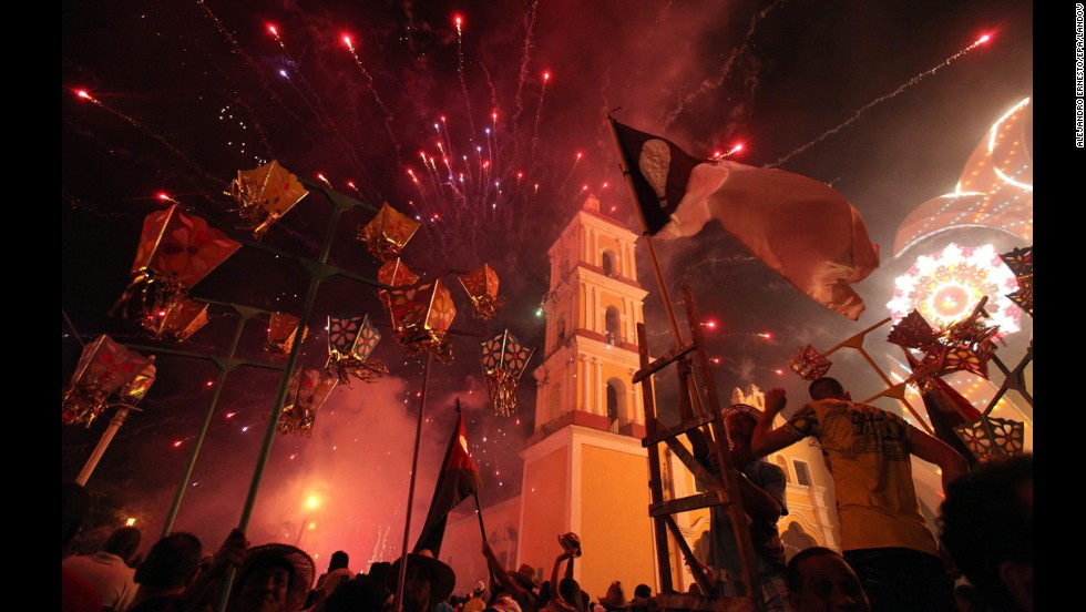 People launch fireworks during the traditional celebrations of Parrandas de Remedios in Villa Clara, San Juan de los Remedios, Cuba. Parrandas, the oldest celebration of Cuba, was declared a national heritage this year.