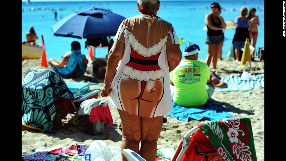 People enjoy Waikiki Beach on Christmas Day in Honolulu.
