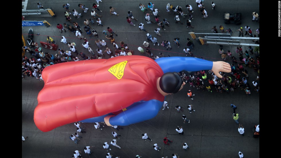 A giant balloon Superman participates in the Christmas parade in Acapulco, Mexico.