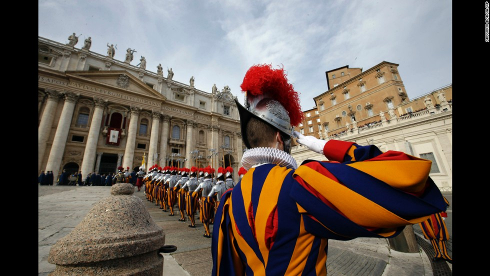 Swiss guards march prior to the start of the Pope's message.