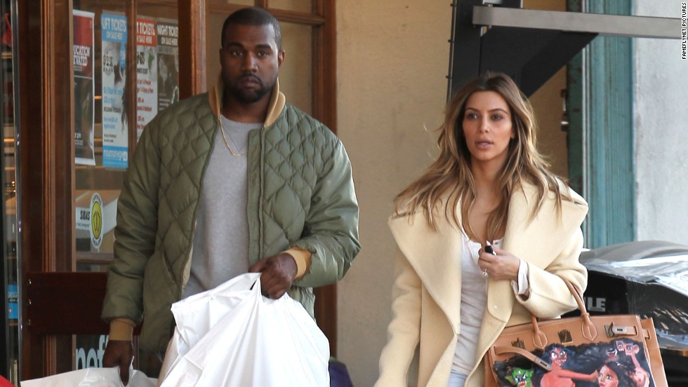 Kanye West  and Kim Kardashian shop at a sporting goods store in Los Angeles on December 26.