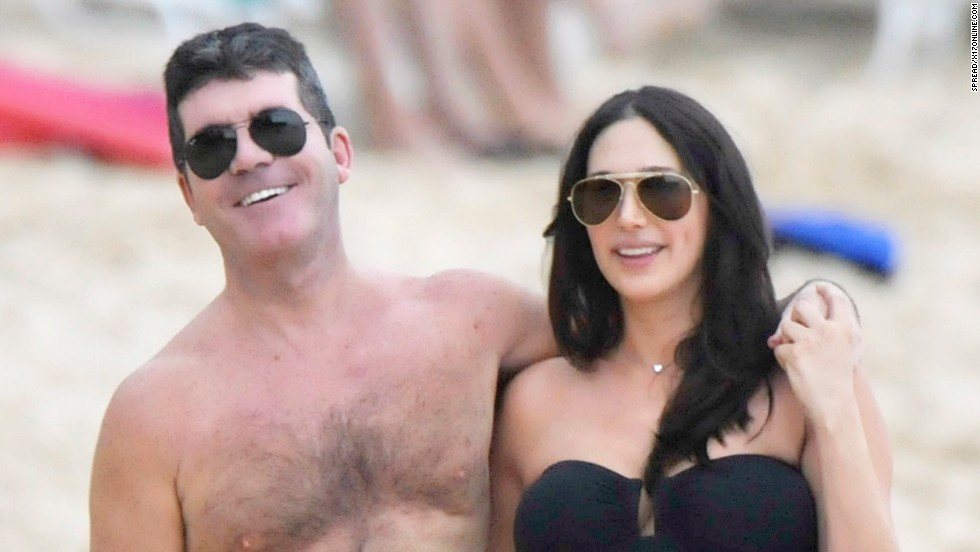 Simon Cowell and his pregnant girlfriend, Lauren Silverman, were all smiles at the beach in Barbados on December 26.