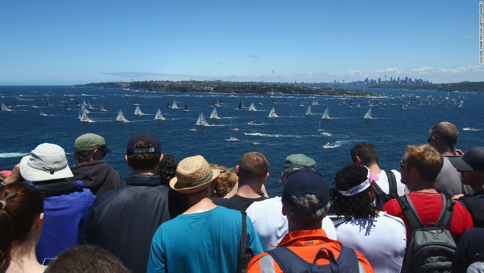 While world-record crowds have been watching Australia take on England in the Ashes cricket Test in Melbourne, flocks of people also turned out in Sydney for the start of the yacht race.