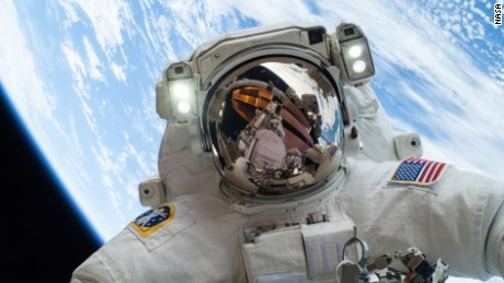 On Dec. 24, 2013, NASA astronaut Mike Hopkins, Expedition 38 Flight Engineer, participates in the second of two spacewalks, spread over a four-day period, which were designed to allow the crew to change out a degraded pump module on the exterior of the Earth-orbiting International Space Station. He was joined on both spacewalks by NASA astronaut Rick Mastracchio, whose image shows up in Hopkins' helmet visor.