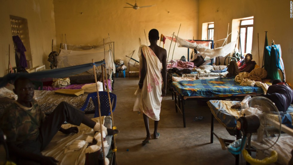 A man walks in a ward where most patients are soldiers with gunshot wounds inside the Juba Military Hospital in Juba on Saturday, December 28.