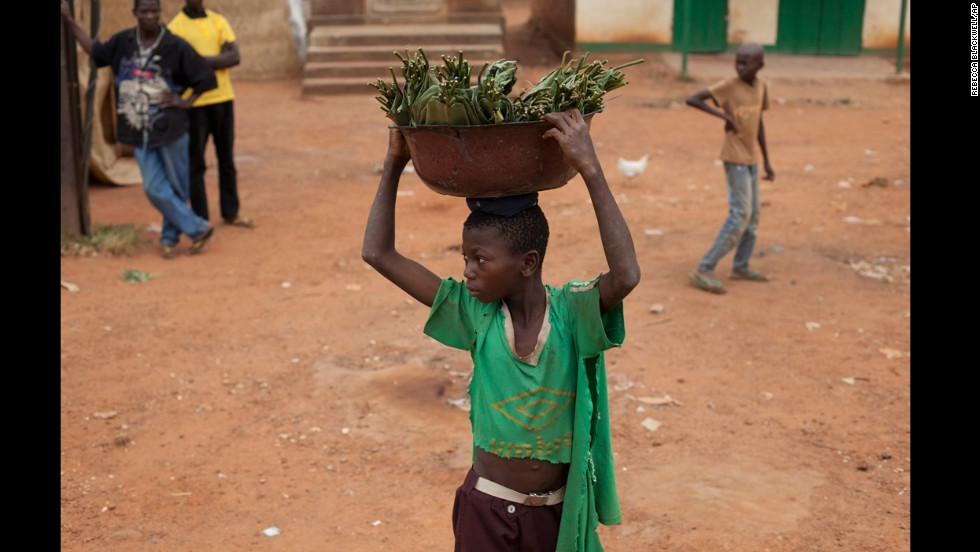 A young boy watches as people hurl rocks at passing vehicles carrying Muslims in the Gobongo neighborhood December 27.