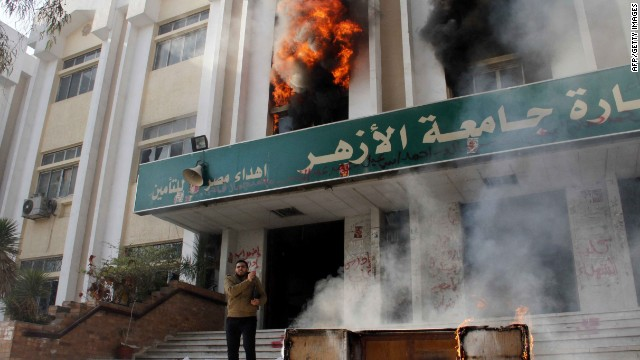 A man stands outside a faculty building at Cairo's Al-Azhar University after student supporters of the Muslim Brotherhood stormed it on December 28, 2013