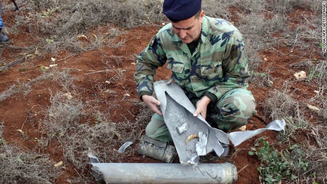A Lebanese soldier examines of one 20 the shells that were fired by the Israeli army into southern Lebanon on December 29, 2013.