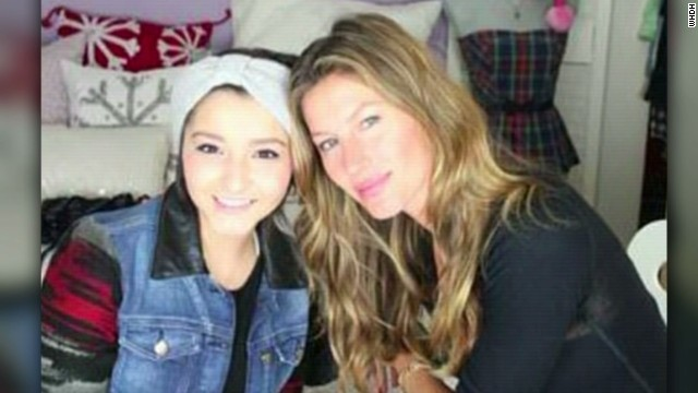 Supermodel surprises cancer patient