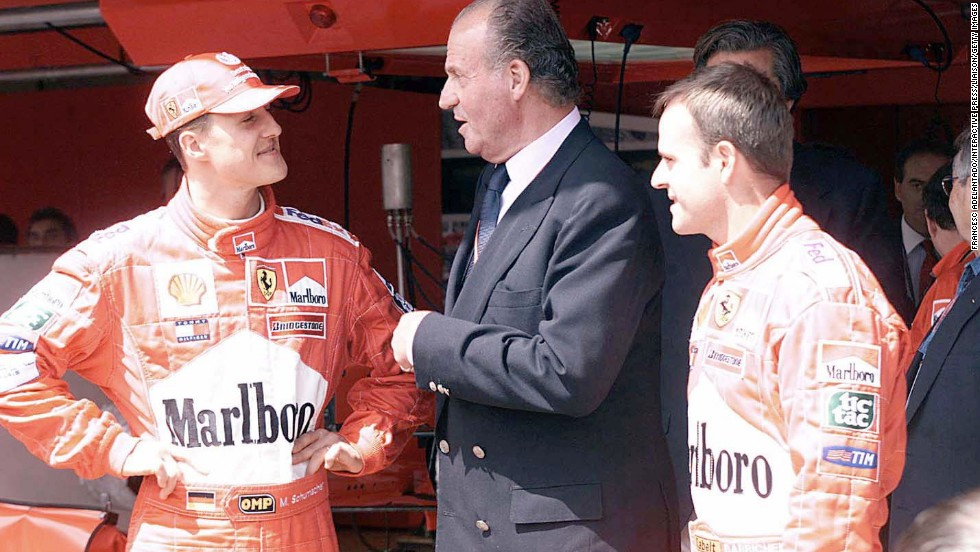 King Juan Carlos of Spain congratulates Schumacher after he won the Spanish Formula 1 Grand Prix in 2001.