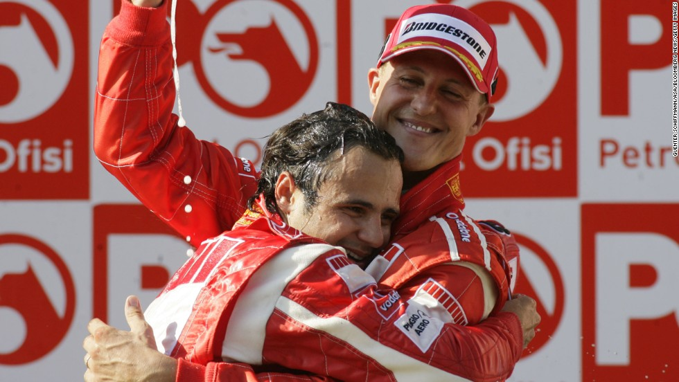 Felipe Massa hugs Schumacher after Massa won first place in the Formula 1 Grand Prix of Turkey in Istanbul in 2006.