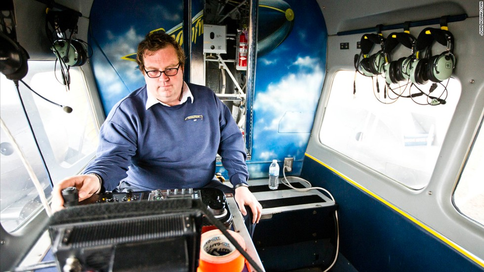 Camera operator Tom O'Keefe goes over the camera controls inside the blimp's gondola.