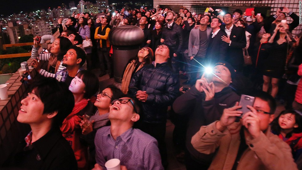 People watch a fireworks display during celebrations in Taipei, Taiwan.