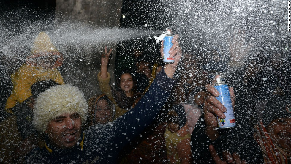 Pakistani youth gather to celebrate New Year's on a street in Lahore.