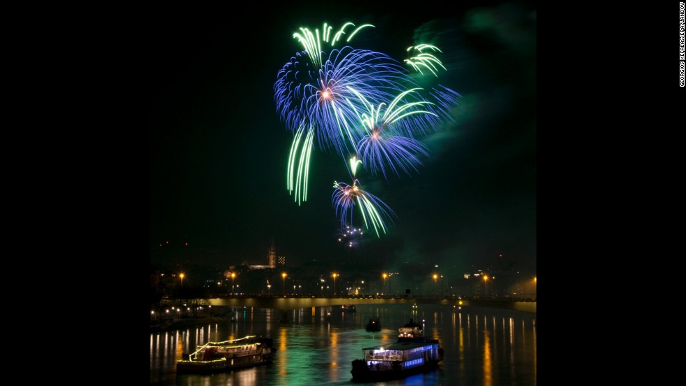 New Year's fireworks illuminate the Rhine River in Basel, Switzerland.