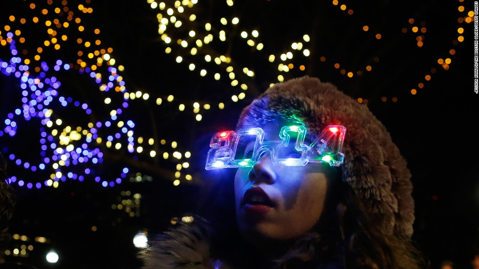 Isabel Lord wears a pair of 2014 glasses during First Night in Boston, Massachusetts, on December 31.
