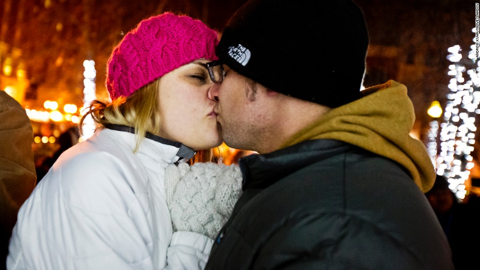 Brad and Amber Kerman of Ventura, California, kiss as the ball drops during the New Year's Eve party in Grand Rapids, Michigan, on Wednesday, January 1.