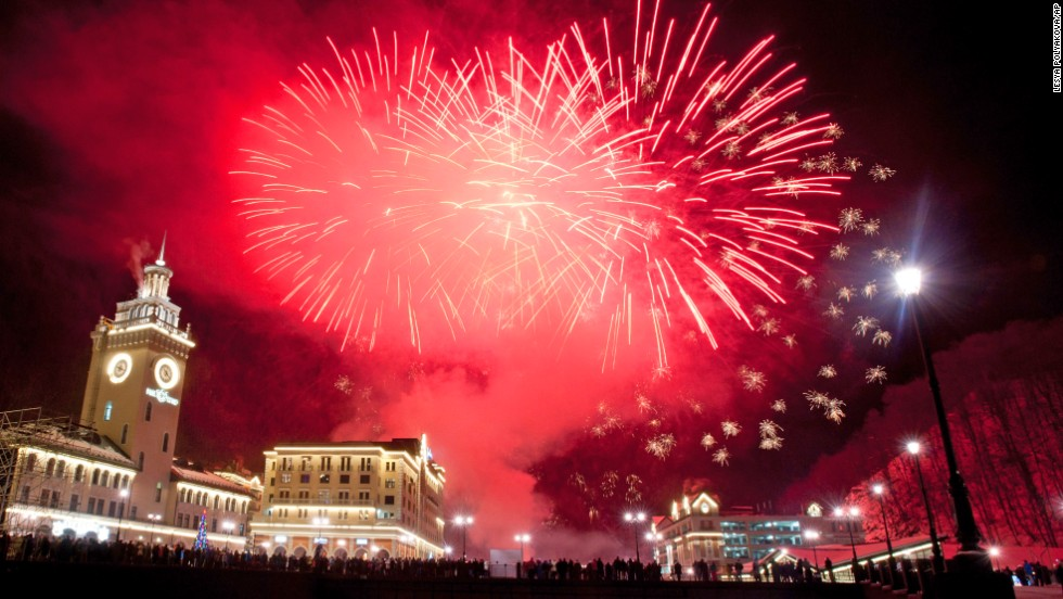 Fireworks explode above the central square of Rosa Khutor ski resort, a venue of the 2014 Winter Olympics, in Krasnaya Polyana, near Sochi, Russia during New Year's celebrations.