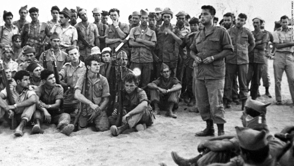 Ariel Sharon addresses troops of Unit 101 before their attack on Khan Yunis in what was formerly known as the Gaza Strip on August 30, 1955. Sharon had established the elite commando group two years before. The officer-turned-politician had a career marked with victories and controversies.