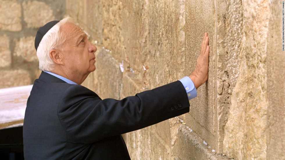 Sharon made a political comeback in the 1990s, eventually becoming leader of the Likud party in 2000. In February 2001, the prime minister-elect touches the ancient stones of the Western Wall as he prays at Judaism's holiest site in Jerusalem. He took office the following month.