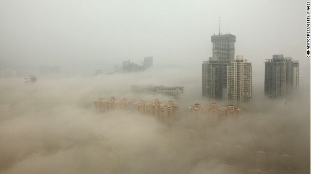 Buildings shrouded in smog in Lianyungang, a city in Northeastern China in December 2013.