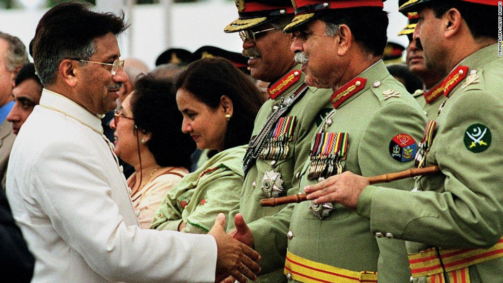 Musharraf shakes hands with military officials in 2001.