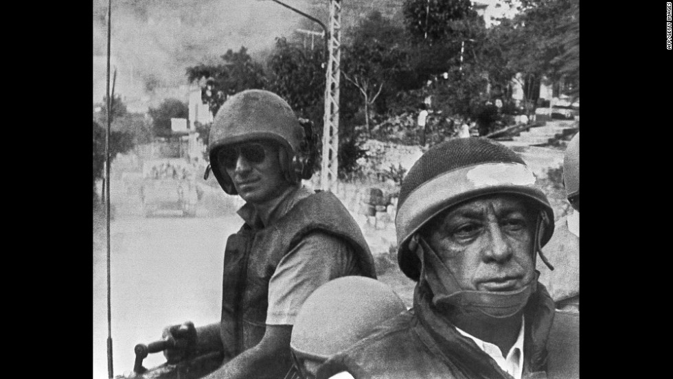 Israeli Defense Minister Ariel Sharon, in combat helmet and flak jacket, leads his troops toward a meeting with Christian forces in East Beirut in June 1982. Israel had invaded southern Lebanon in retaliation for an assassination attempt linked to the group Abu Nidal.