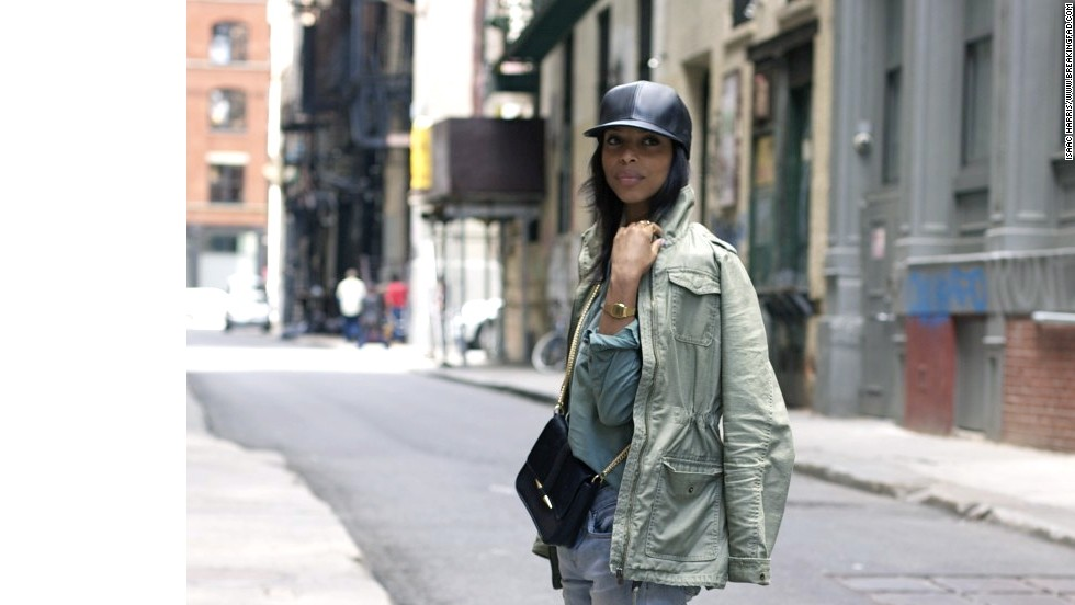"Lloyd layers a military green work shirt and anorak for what she calls an ""urban camouflage feel."""