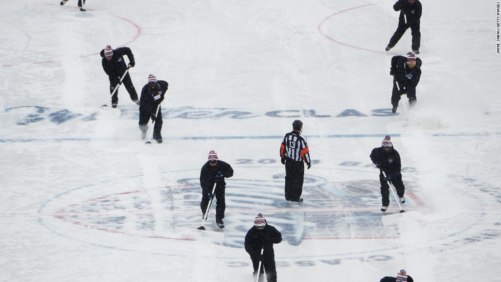 Play was stopped twice in the first period in order for crews to shovel snow off the ice.