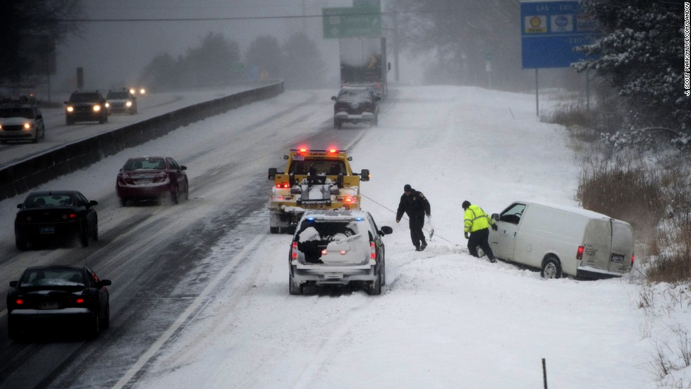 A van is pulled from a ditch along Interstate 94 in Jackson, Michigan, on January 2.