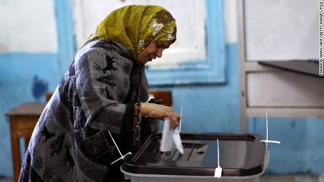 An Egyptian woman casts her ballot at a polling station during the second round of a referendum on a new draft constitution in Giza, south of Cairo, on December 22, 2012. Egyptians are voting in the final round of a referendum on a new constitution championed by President Mohamed Morsi and his Islamist allies against fierce protests from the secular-leaning opposition. AFP PHOTO/MAHMUD HAMS (Photo credit should read MAHMUD HAMS/AFP/Getty Images)