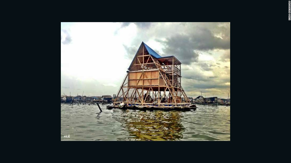 """This prototype was constructed to provide teaching facilities for the slum district of Makoko, a former fishing village on Lagos Lagoon where over 100,000 people live in houses on stilts. Shortlisted for a <a href=""""https://designmuseum.org/exhibitions/future-exhibitions/designs-of-the-year"""" target=""""_blank"""">Designs of the Year Award</a> in 2014, the school was built by a team of local residents, but was decommissioned in March 2016 and eventually collapsed following heavy rains."""