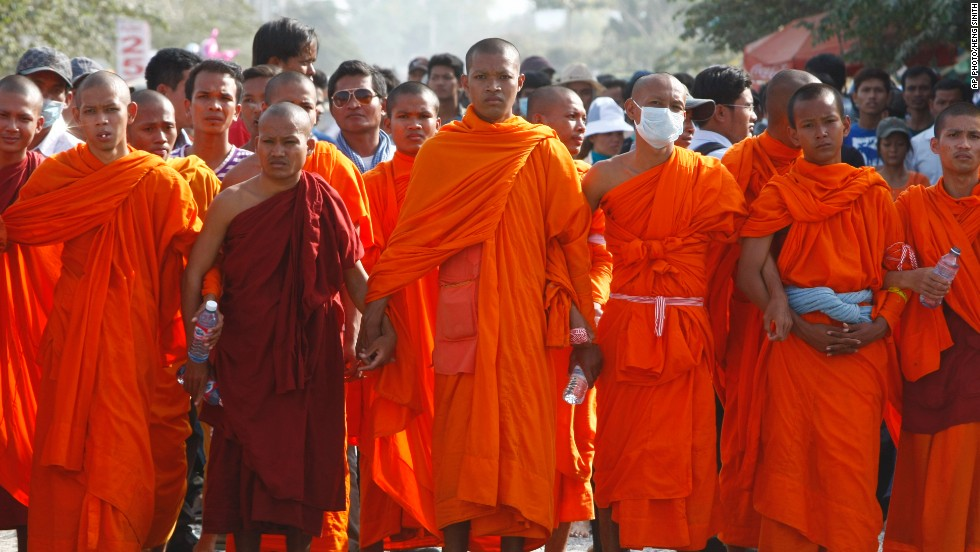 Cambodian Buddhist monks stand together to form a barricade as they participate in a garment workers' strike outside a factory on the outskirts of Phnom Penh on Thursday.
