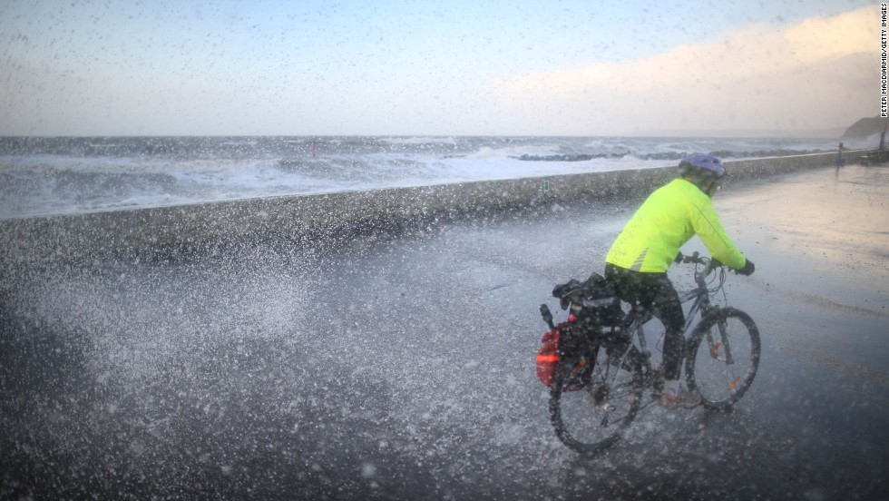 A cyclist gets a soaking on the West Bay seafront in Dorset, England, on January 3.