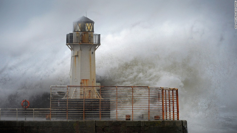 Waves crash over the Ardrossan Harbor Lighthouse in Ardrossan, Scotland, on January 3.
