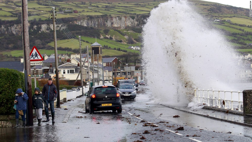 Large waves crash onto a road in the coastal village of Carnlough, Northern Ireland, on January 3.