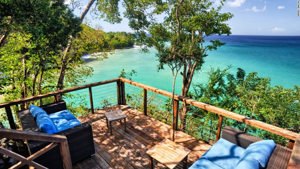 At Secret Bay in Dominica guests stay in one of five tree house-style villas and bungalows.