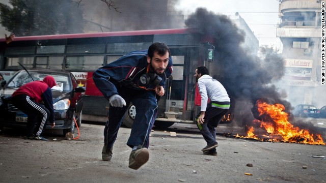 Supporters of Egypt's deposed president Mohamed Morsi run for cover during clashes in Cairo's Nasr City on January 3.