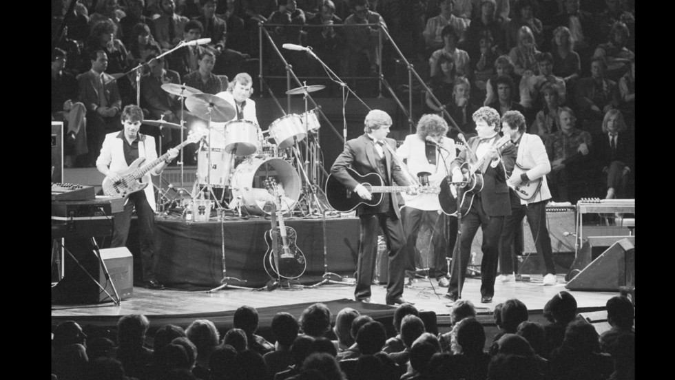 The Everly Brothers and their band performing at their reunion concert at the Royal Albert Hall, London, in September 1983. From left, Mark Griffiths, Graham Jarvis, Phil Everly, Albert Lee, Don Everly and Martin Jenner.