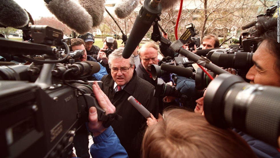 Robert Bennett, Clinton's personal attorney, makes his way through a crowd of photographers as he arrives at federal court in Washington on March 5, 1998. Starr's grand jury was questioning witnesses in the Clinton/Lewinsky scandal.