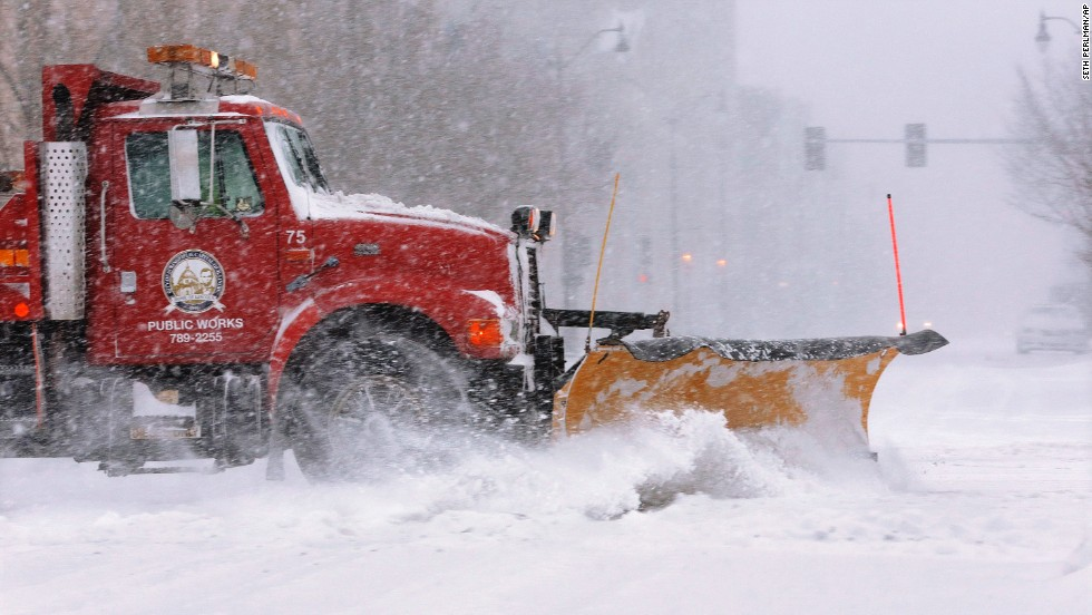 A city snowplow clears the street in an almost-deserted downtown Springfield on January 5.