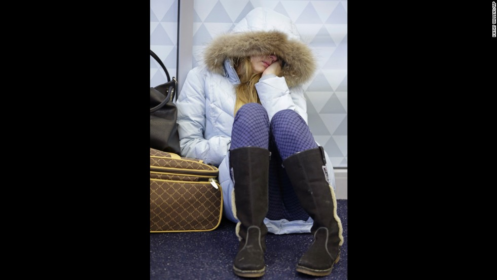 Anna Maksimkina of Yekaterinburg, Russia, sleeps on the floor at John F. Kennedy International Airport in New York after a Delta flight from Toronto to New York skidded off the runway into a snow bank, temporarily halting all flights January 5.
