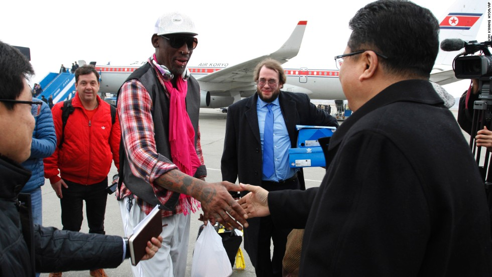 Son Kwang Ho, vice minister of North Korea's Sports Ministry, greets former NBA star Dennis Rodman at the airport in Pyongyang on Monday, January 6.