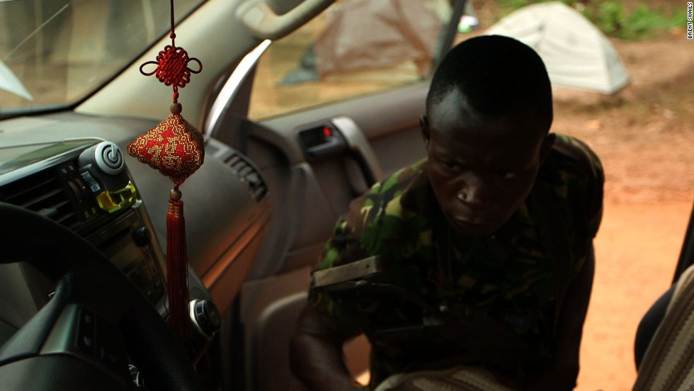 Eco guards search a vehicle at their Yengo checkpoint in Congo.