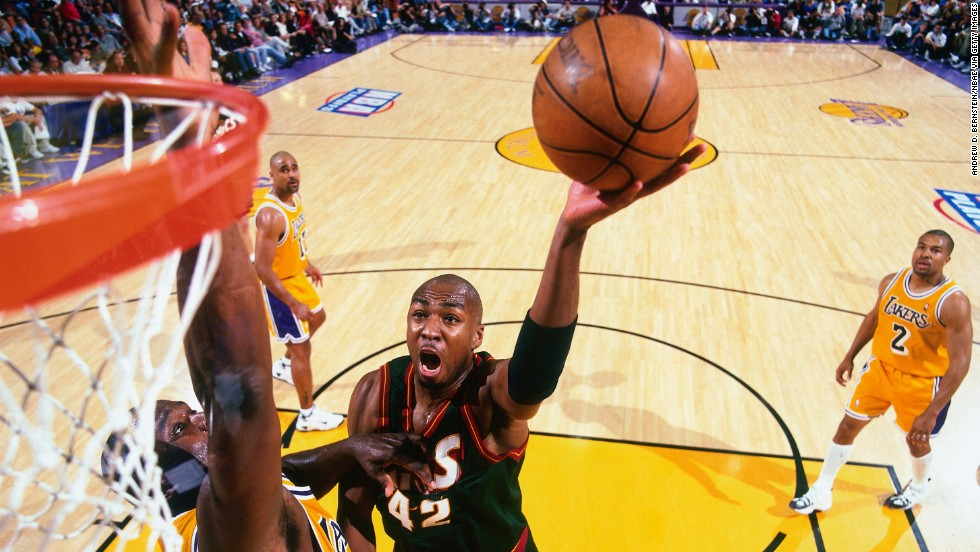 Vin Baker shoots the basketball during a 1998 playoff game in Los Angeles. Baker is one of seven former NBA players taking part in the game in North Korea, according to Rodman's agent, Darren Prince. Baker was a four-time NBA All-Star who averaged 15 points a game during a 13-year career that ended in 2006.