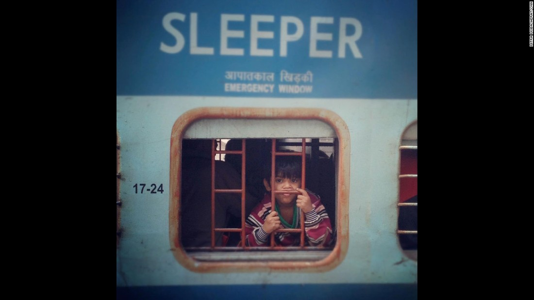 """INDIA: A young boy stares out the window of a train at the Old Delhi Railway Station. Indian Railways transports some 15 million passengers a day. Photo by CNN's Mitra Mobasherat.<br />Follow <a href=""""http://instagram.com/mitracnn"""" target=""""_blank"""">@mitracnn</a> and other CNNers on the <a href=""""http://instagram.com/cnnscenes"""" target=""""_blank"""">@cnnscenes</a> gallery on Instagram for more images you don't always see on news reports from our teams around the world."""